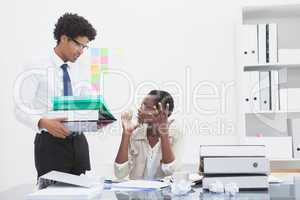 Man giving pile of files to his irritated colleague