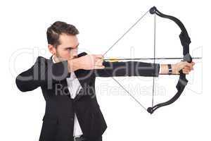 Elegant businessman shooting bow and arrow