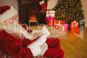 Concentrated santa writing list on scroll