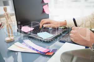 Designer using laptop and digitizer