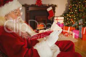 Santa claus writing list on scroll