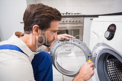 Handyman fixing a washing machine