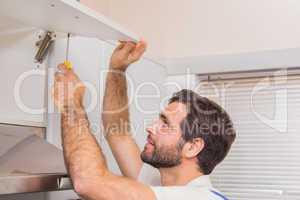 Handyman putting up a shelf