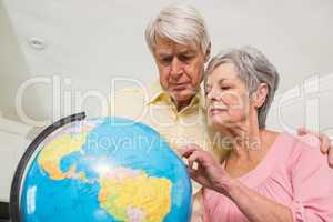 Senior couple choosing a travel destination