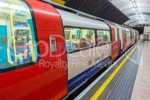 LONDON - SEPTEMBER 28, 2013: Subway train in underground station