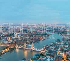 London at night. Aerial view of Tower Bridge area and city light