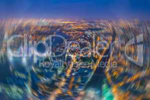 London at night. Blurred aerial view of Tower Bridge area and ci