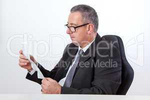 Man reading instruction manual on the desk