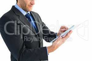 Mid section of a businessman using digital tablet
