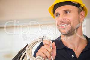 Construction worker posing with cables