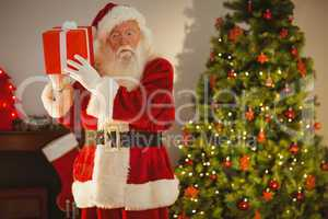 Father christmas delivering gift at christmas eve