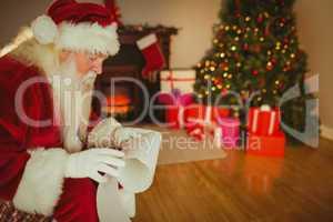 Santa claus reading his list