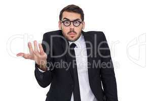 Doubtful businessman with glasses gesturing