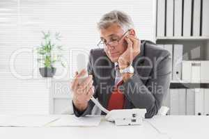 Smiling businessman put on hold