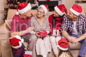Festive family speaking together at christmas