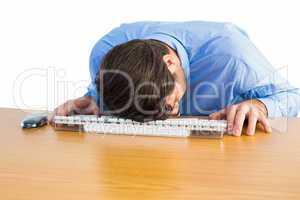 Businessman sleeping on his keyboard
