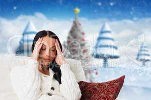 Composite image of woman suffering from a migraine