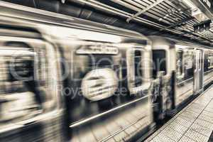 Fast moving train in Manhattan subway - New York transportation