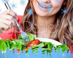 Composite image of close up of a delighted woman is eating a sal