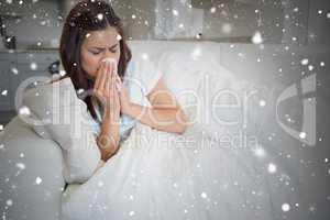 Composite image of brunette feeling ill on sofa