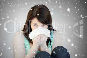 Composite image of portrait of a sick attractive woman blowing