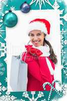 Composite image of beautiful festive woman holding shopping bag