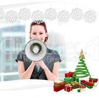 Confident businesswoman yelling through a megaphone
