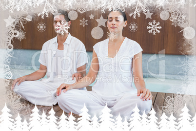 Attractive couple in white sitting in lotus pose