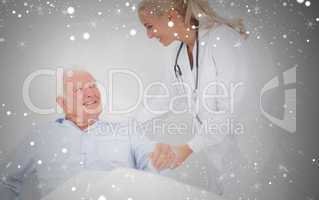 Composite image of doctor helping elderly man to sit up