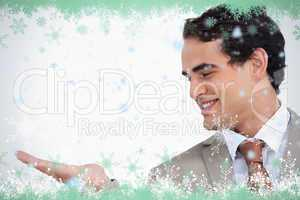 Close up of smiling salesman looking at his palm