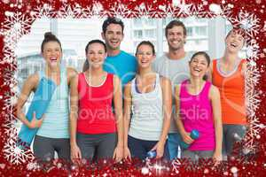 Portrait of fit people smiling in exercise room