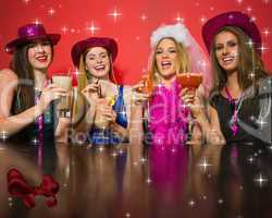 Composite image of laughing friends having hen party holding coc