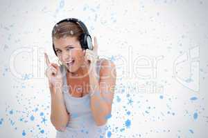 Cheerful woman dancing while listening to music