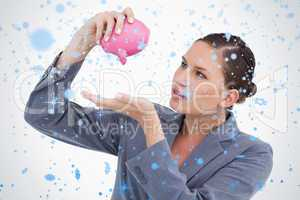 Bank clerk emptying piggy bank