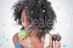 Young woman going to eat a delicious green apple