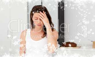 Composite image of exhausted woman having a headache in her bath