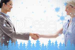 Close up of women shaking hands
