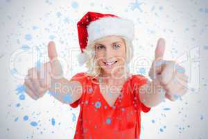 Smiling young woman putting her thumbs up in satisfaction