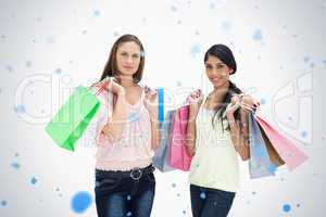 Composite image of woman with shopping bags