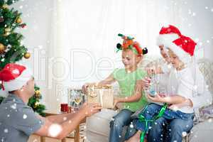 Happy father giving a present to his daughter sitting on the sof
