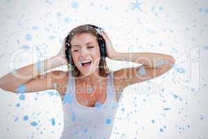 Happy woman singing while listening to music