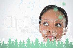 Close up of womans face looking upwards diagonally on white background