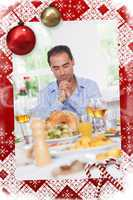 Man saying grace before dinner