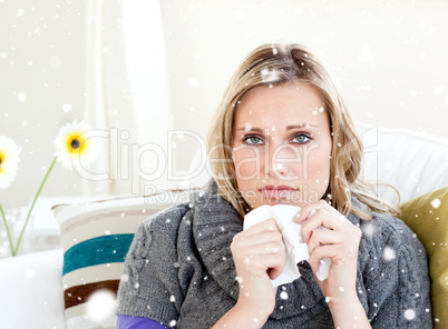 Composite image of unhealthy woman sitting on a sofa