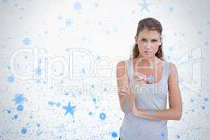 Unhappy woman pointing at the viewer