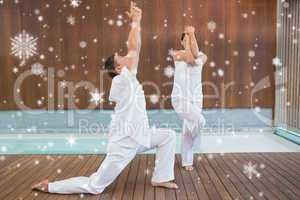 Peaceful couple in white doing yoga together