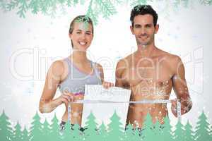 Sporty couple holding scales and measuring tape
