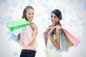 Smiling women with a lot of shopping bags