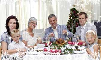 Composite image of family eating turkey in christmas eve dinner