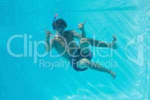Young man wearing snorkel underwater